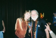 Jan Sikes and Willie after the concert. Look at the sweat under Willie's arm. He was exhausted and I don't know where my smile was. I think I was just feeling his exhaustion.